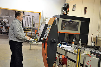 Alex Gluskin programs the automated CNC multi-tool workstation