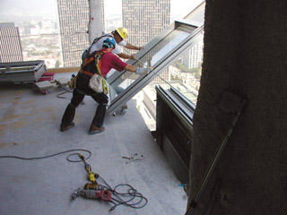 Unitized Curtainwall Panel Being Installed. Photos Courtesy Of Halfen  Anchoring Systems.